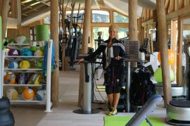 Panorama gym with modern equipment and a personal trainer for top quality training.