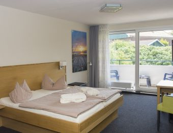 Organic junior suite with balcony - Biohotel Strandeck