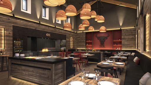 Hier erfüllt Holzkohle-Duft den Raum, während herzhafte Steaks auf dem Feuer des Holzkohlegrills zubereitet werden.