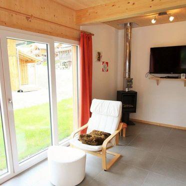 livingroom with oven, Chalet Spatzennest, Hohentauern, Steiermark, Styria , Austria