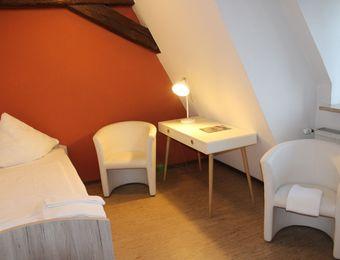 Doppel-/Mehrbettzimmer mit Gemeinschaftsbad - Biohotel Schloss Kirchberg